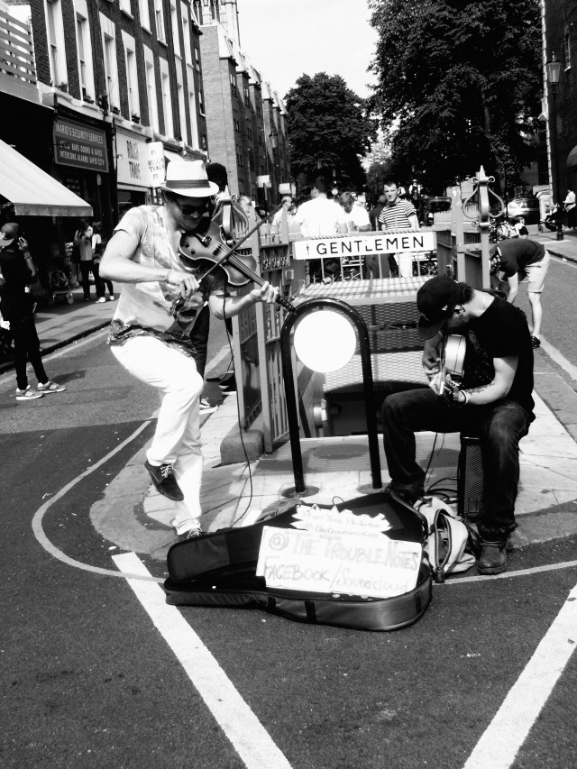 Very cool street performers...literally performing in the middle of the street!